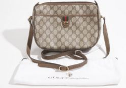 A Gucci handbag in a dustbag.