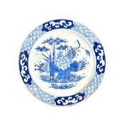 A large Bow blue and white plate, circa 1760-65, painted in the centre with a lotus flower,
