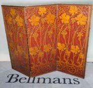 An embossed leather three fold screen, 156cm wide x 124cm high.