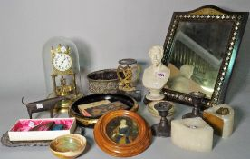 Collectables in a brass anniversary style clock with dome, marble bust, postal scales,