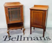 An Edwardian mahogany side cabinet with a glazed door on cabriole supports, 48cm wide x 91cm high,