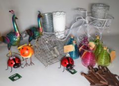 A group of 20th century decorative garden items, including metal peacocks, wasp catchers,