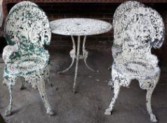 A white painted cast aluminium garden table, 69cm diameter x 82cm high,