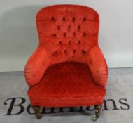 A late Victorian stained beech framed low armchair,