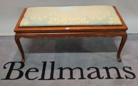 A mid-20th century Chinese hardwood rectangular footstool with floral upholstered seat,