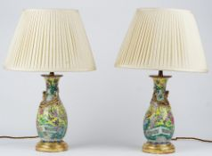 A pair of 20th century Chinese porcelain table lamps and shades, 48cm high, (2).