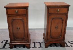 A pair of modern mahogany single drawer bedside cupboards on bracket feet, 32cm wide x 68cm high,