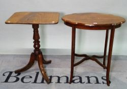 An Edwardian inlaid mahogany oval side table united by an X- frame stretcher, 67cm wide x 71cm high,