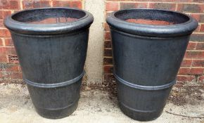 A pair of terracotta plant pots of tapering form, 56cm diameter x 70cm high, (2).