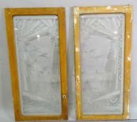 A pair of painted pine frames inset with etched glass panels depicting 19th century Dutch scenes,