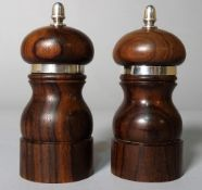 A pair of modern silver mounted hardwood pepperettes, 11cm high, (2).