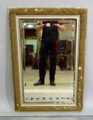 A late 19th century French silver painted and parcel gilt decorated rectangular wall mirror with