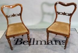 A pair of Victorian rosewood bar back side chairs, 46cm wide x 85cm high.
