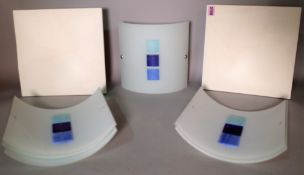 A pair of modern cream geometric panel wall lights, 29cm x 29cm, and six curved glass wall lights,