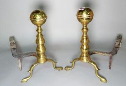 A pair of early 20th century brass and cast iron andirons, 42cm high, (2).