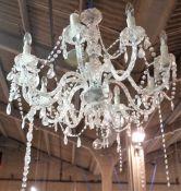 A modern glass nine branch chandelier, 80cm wide.