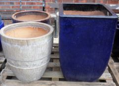 A pair of modern garden pots, 51cm wide x 52cm high and another similar,