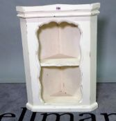 A modern white painted hanging corner cabinet, 40cm wide.