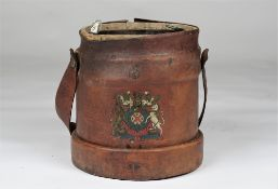A 19th century leather bound shot carrier with a coat of arms to the front,