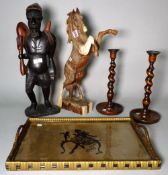 A hardwood figure of a horse, 48cm high, and another hardwood figure of a man , 51cm high,