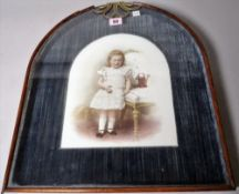 A late 19th century German porcelain plaque of a young girl within a ormolu mounted mahogany