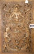 A 19th century carved wall plaque with acanthus decoration, 30cm x 23cm.