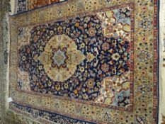 An indigo rug, the indigo field with central medallion, 191cm x 124cm.