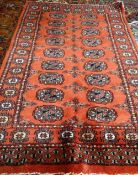 An Indian Bokhara rug, with madder field, 116cm x 80cm.