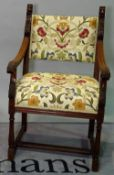 An 18th century style mahogany framed bar square back open armchair with carved lion surmounts,
