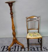 A Victorian style stained beech jardiniere stand on turned column, 25cm diameter x 112cm high,