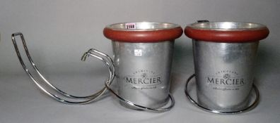 'Mercier', a pair of modern stainless steel champagne buckets with table holders,