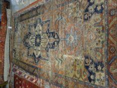 A Tabriz carpet, the madder field with large medallion, 320cm x 161cm.