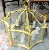 A set of five gilt metal and glass wall lights, 34cm tall, and an octagonal glazed ceiling light,