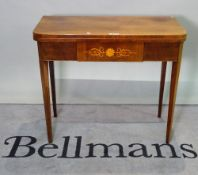An early 19th century inlaid mahogany French foldover tea table on tapering square supports,