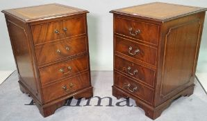 A pair of 20th century stained beech two drawer filing cabinets with inset tan leather tops,