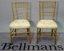 A pair of early 20th century gold painted faux bamboo side chairs, 42cm wide x 85cm high, (2).