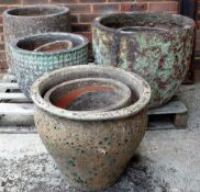 A quantity of modern garden pots of various sizes, the largest being 57cm wide x 50cm high (12).