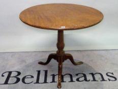 A George III mahogany tripod table on turned column with downswept pad feet, 82cm wide x 88cm high.