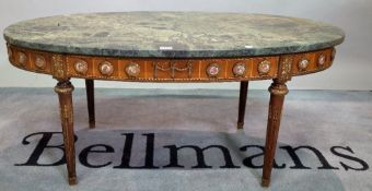 A Continental oval walnut coffee table with green marble top and applied porcelain plate decoration,