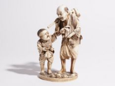 A Japanese ivory okimono of a man and boy, both standing, the man carrying an axe and hare, signed,