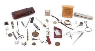 A small group of collectables, including; a leather cigar case, a small magnifying lens,