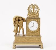 A 19th century gilt bronze figural mantel clock with two children hiding under a blanket and floral