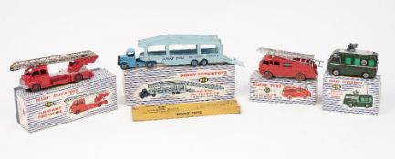 Four Dinky die-cast vehicles, a 955 Fire engine with extending ladder, a 956 Turntable fire escape,