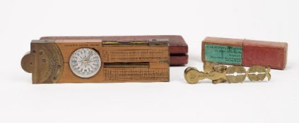 A Negretti and Zambra boxwood and brass multi-functional folding ruler including; compass,