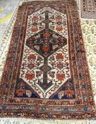 A Hamadan rug, Persian, the ivory field with a diamond medallion; all with a stylised herate design,