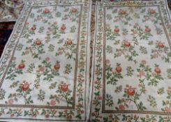A pair of modern cross stitch decorative Portuguese rugs,