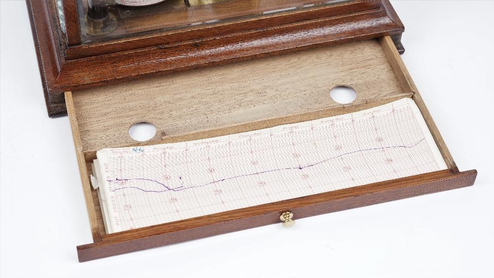 Lot 1266 - A 20th century oak cased barograph, un-signed,