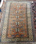 A Perepedil rug, Caucasion, the madder field with five ivory medallions and six ram's horns,