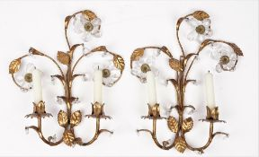A pair of modern gilt metal two branch wall sconces, each foliate cast and hung with crystal drops,