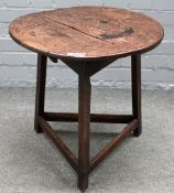A late 18th/early 19th century elm and oak cricket table, with perimeter stretcher,